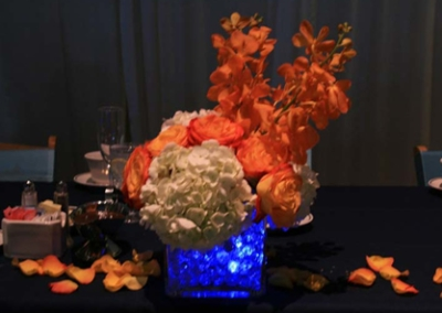 Party pics orange flowers blue ligth in water beads